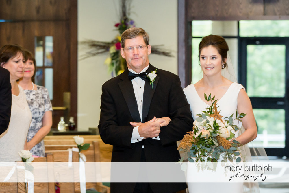 Bride and her father walk down the aisle at Genesee Grande Hotel Wedding