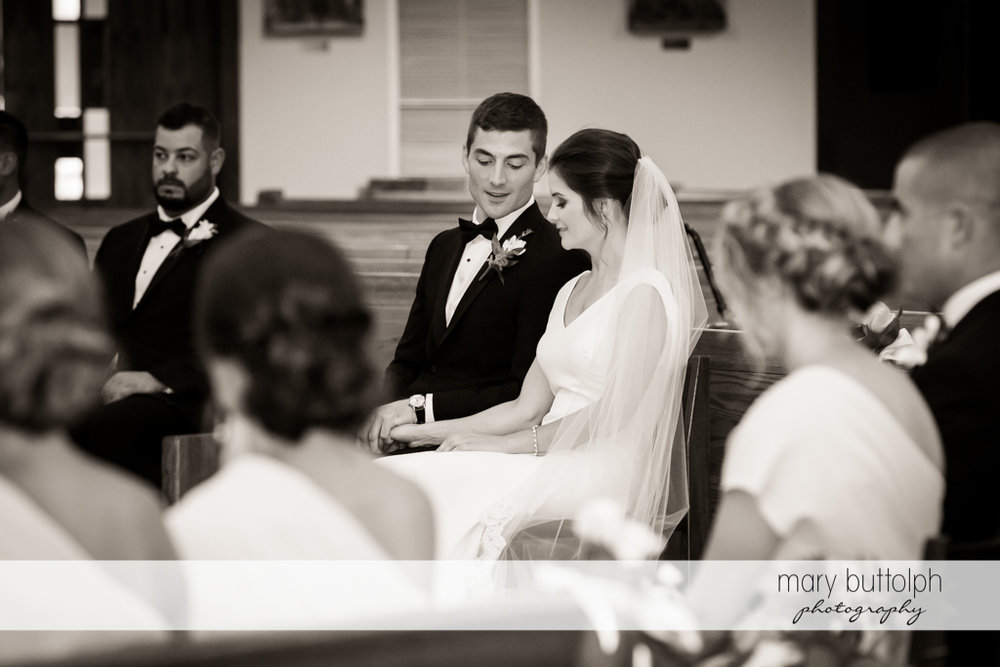 Couple hold hands during the wedding ceremony at Genesee Grande Hotel Wedding
