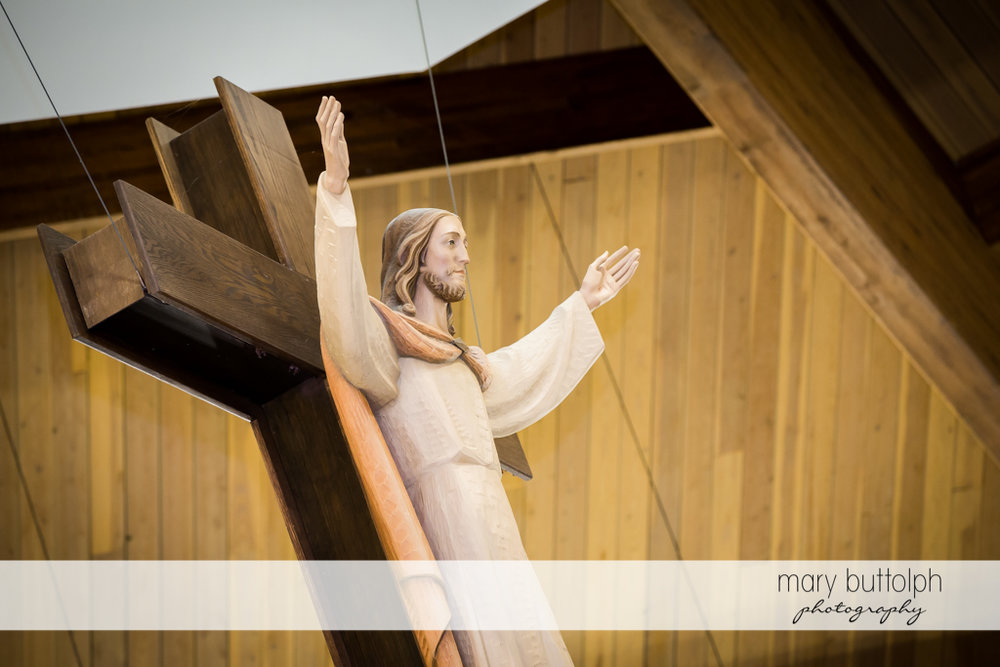 Christ on the cross at the altar at Genesee Grande Hotel Wedding
