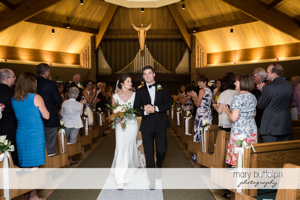 Couple leave church after the wedding at Genesee Grande Hotel Wedding