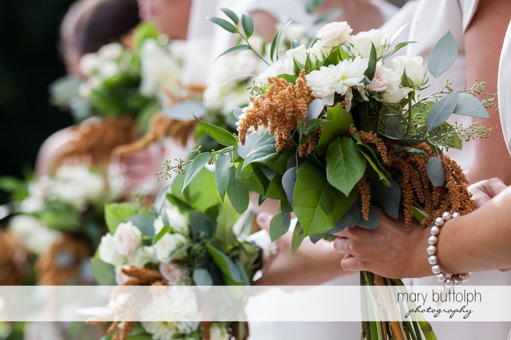 Close up shot of the bouquets of bridesmaids at Genesee Grande Hotel Wedding