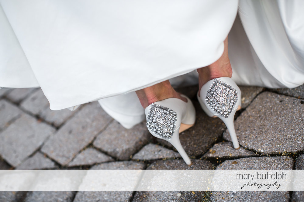 Back view of bride's shoes at Genesee Grande Hotel Wedding