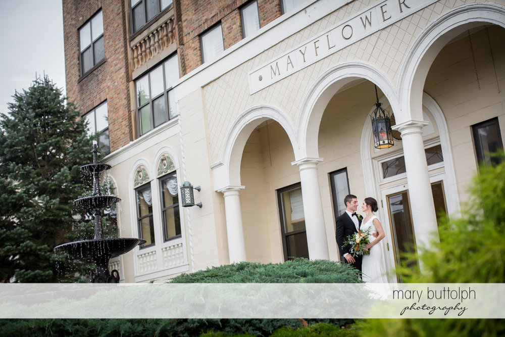 Couple pose in front of the wedding venue at Genesee Grande Hotel Wedding