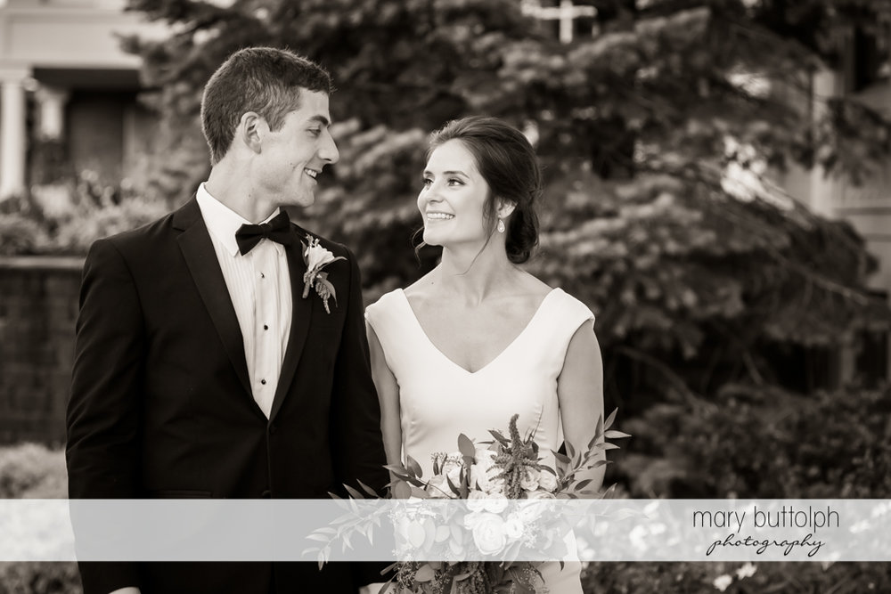 Couple pose in the garden at Genesee Grande Hotel Wedding
