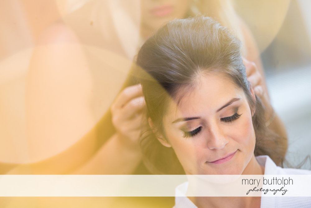 Bride is relaxed as her hair is fixed for her wedding at Genesee Grande Hotel Wedding