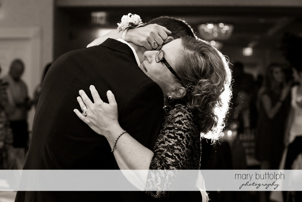 Groom gets a hug from his mother at Genesee Grande Hotel Wedding