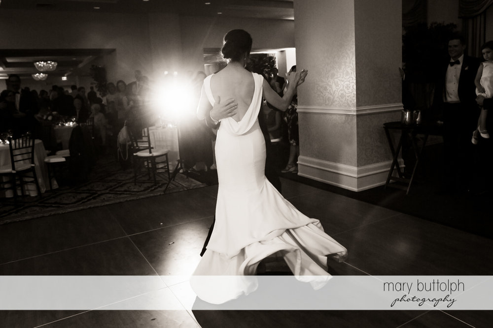 Bride dances with a mystery guest in this trick shot at Genesee Grande Hotel Wedding