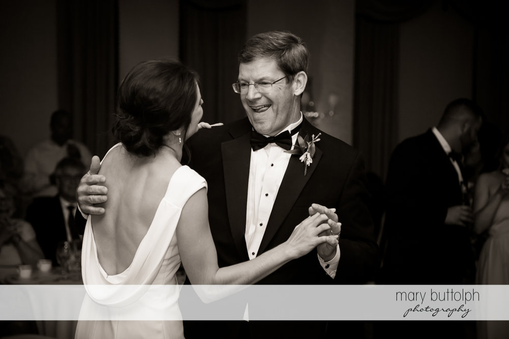 Bride and guest show their moves on the dance floor at Genesee Grande Hotel Wedding