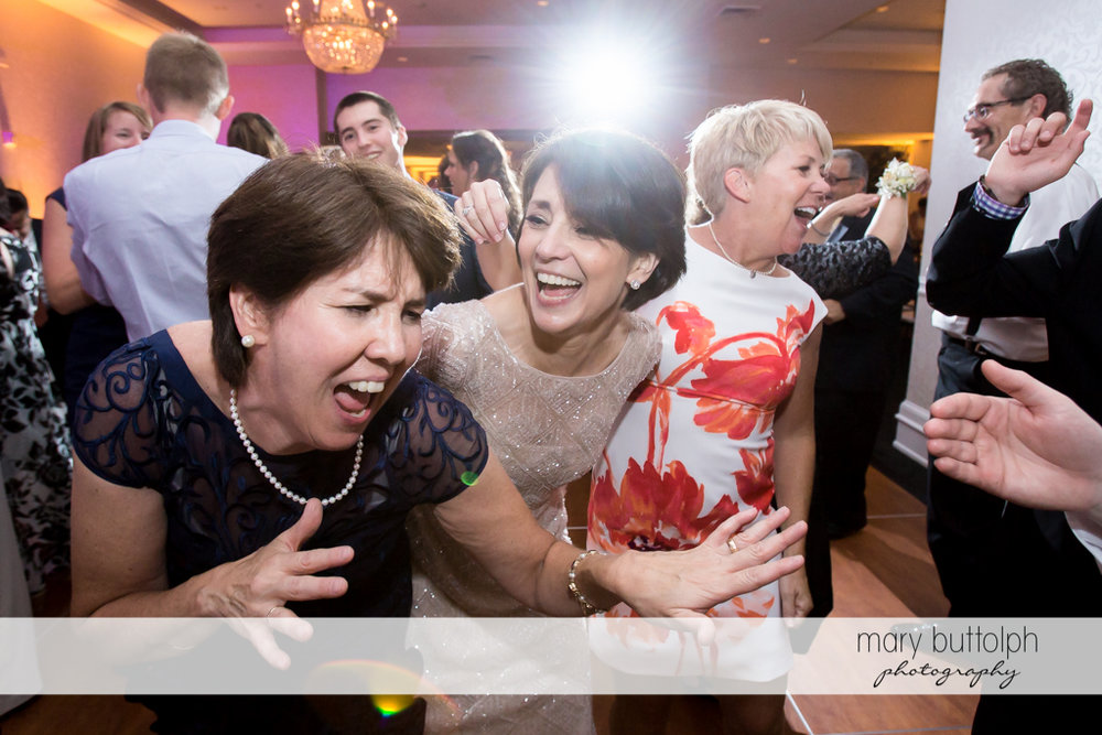 Guests having a great time at the wedding reception at Genesee Grande Hotel Wedding