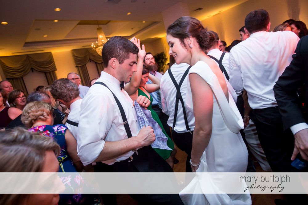 Couple having a ball on the dance floor at Genesee Grande Hotel Wedding