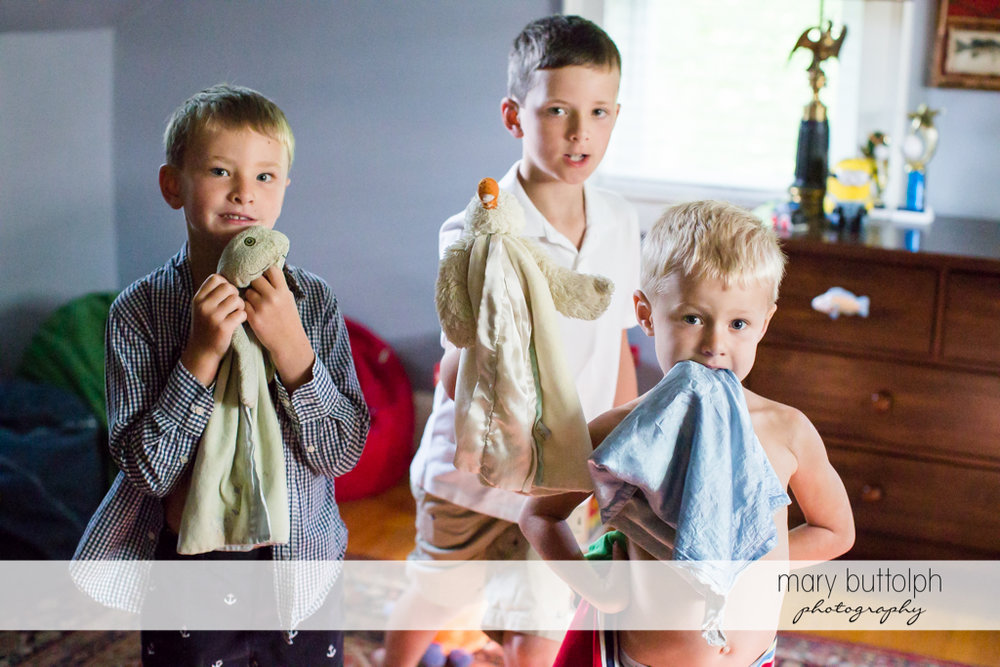 Brothers with their favorite towels in the bedroom at Skaneateles