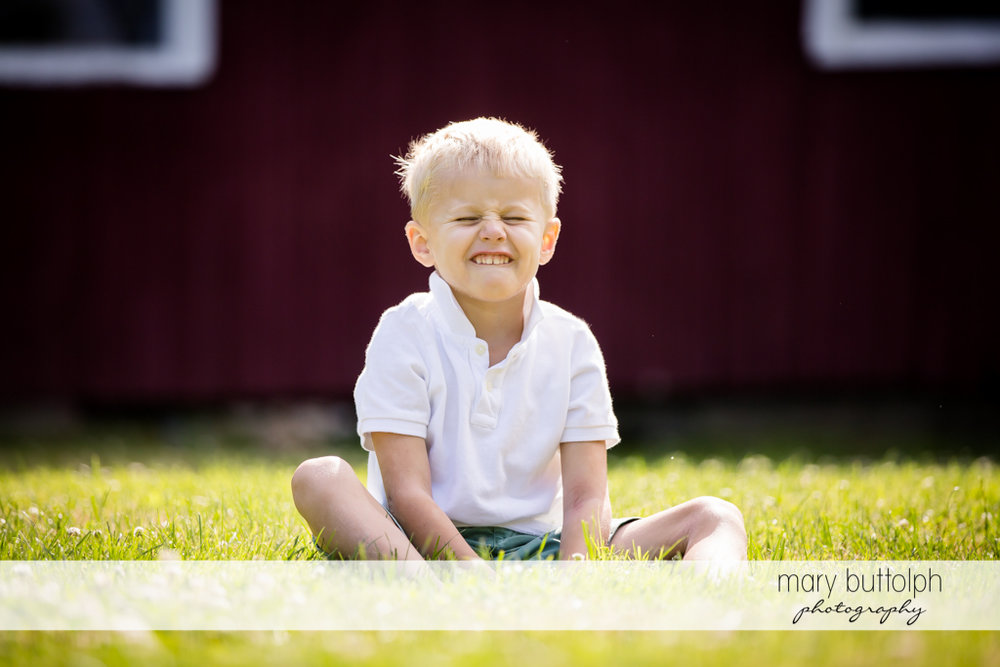 Boy makes a funny face for the camera in front of their home at Skaneateles