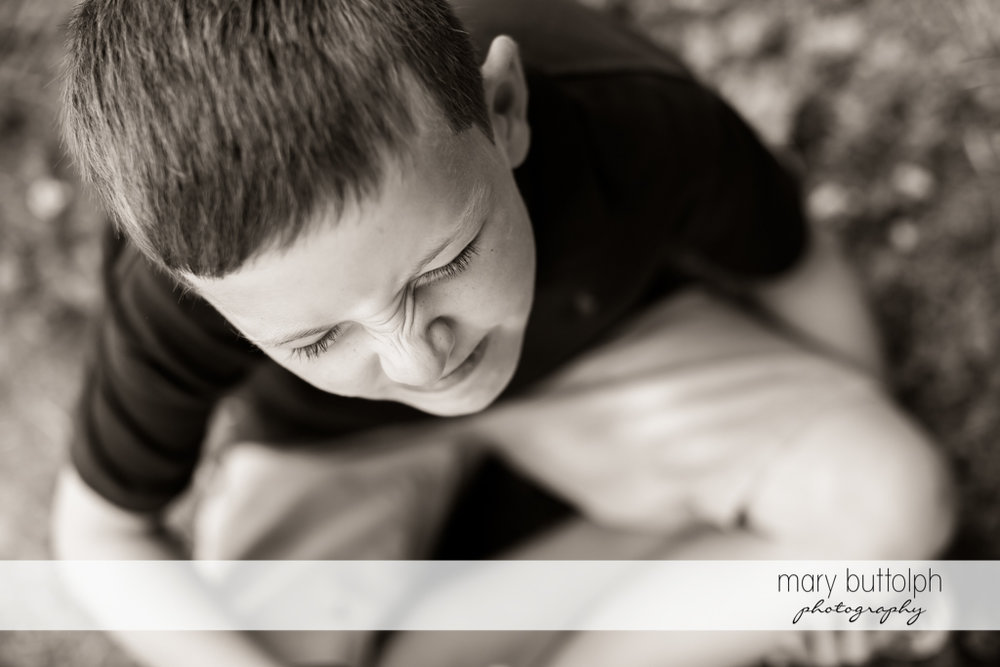 Boy clowns around during the photo shoot at Skaneateles