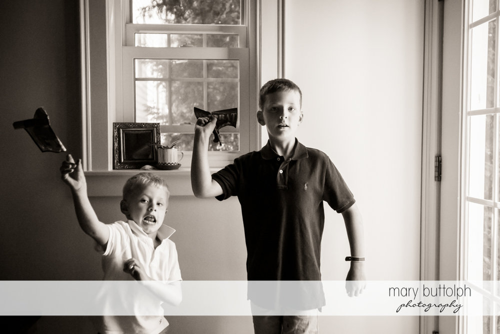 Brothers throw their toy planes at home at Skaneateles