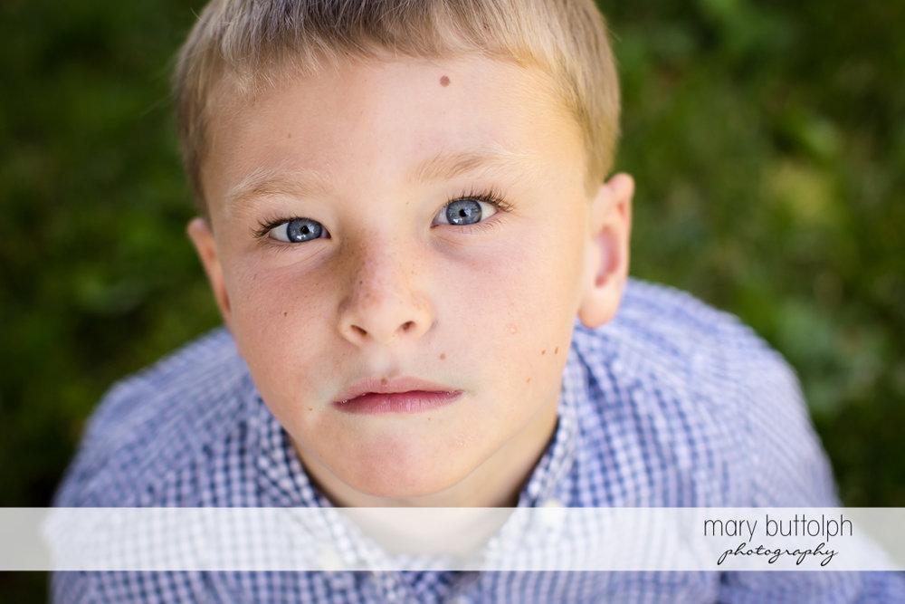 Boy stares at the camera at Skaneateles
