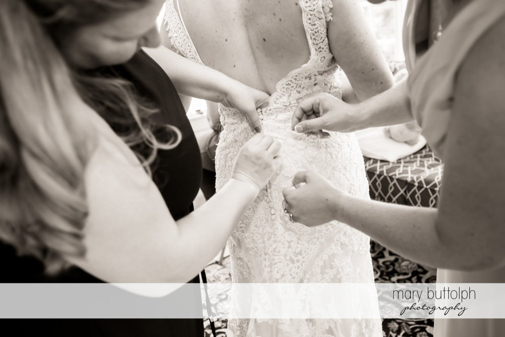 Relatives make some adjustments on the bride's wedding dress at The Sherwood Inn Wedding