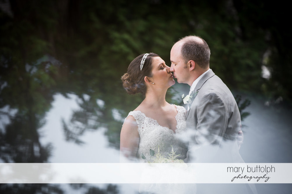 Couple kiss in the garden at The Sherwood Inn Wedding