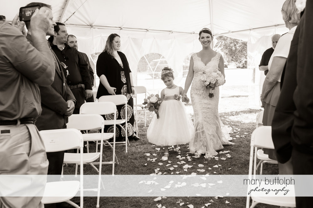Bride and her daughter walk down the aisle in the wedding tent at The Sherwood Inn Wedding