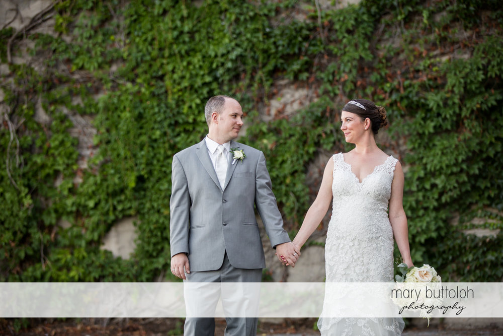 Couple pose in front of a stone wall at The Sherwood Inn Wedding
