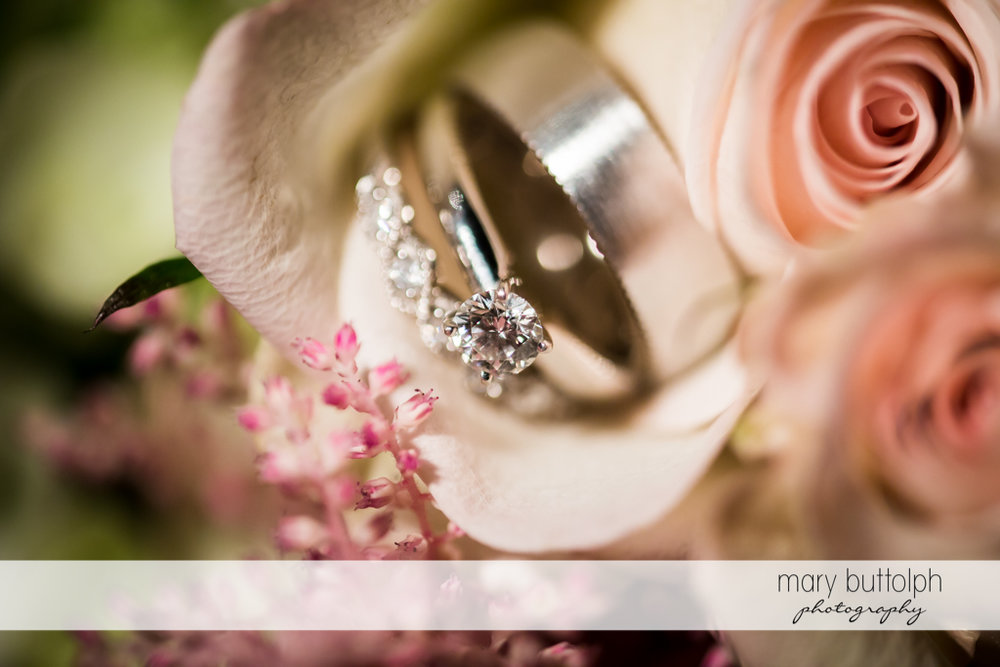 Close up of bride's wedding ring on top of a flower at The Sherwood Inn Wedding
