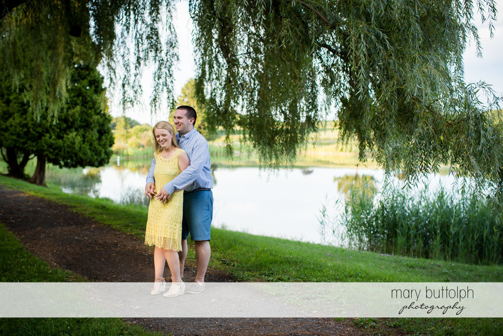 Couple enjoy a quiet afternoon by the lake in Syracuse Engagement