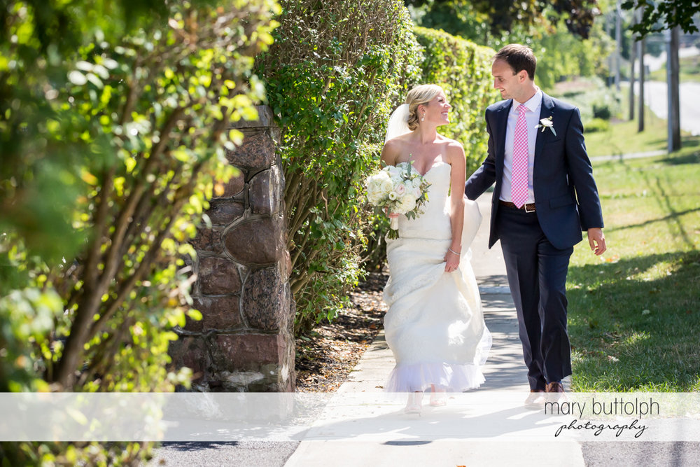 Couple stroll in the garden at Skaneateles Country Club Wedding