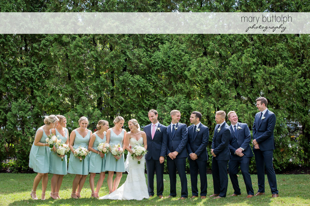 Couple pose with bridesmaids and groomsmen at Skaneateles Country Club Wedding