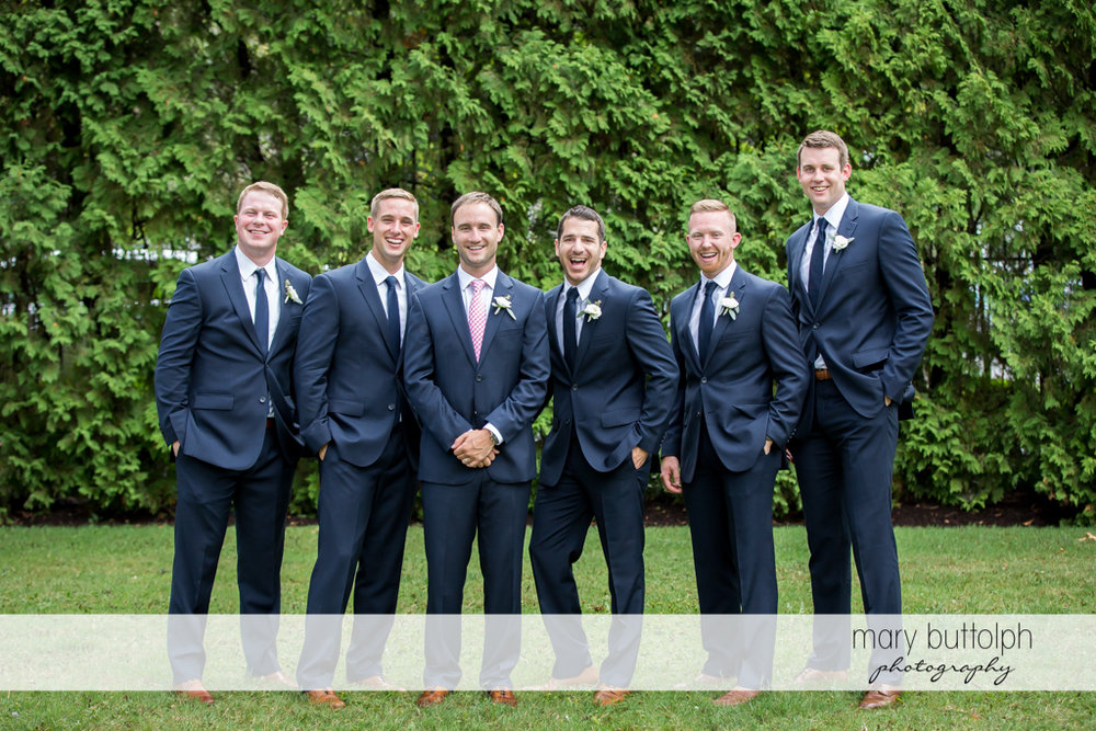 Groom poses with his groomsmen at Skaneateles Country Club Wedding