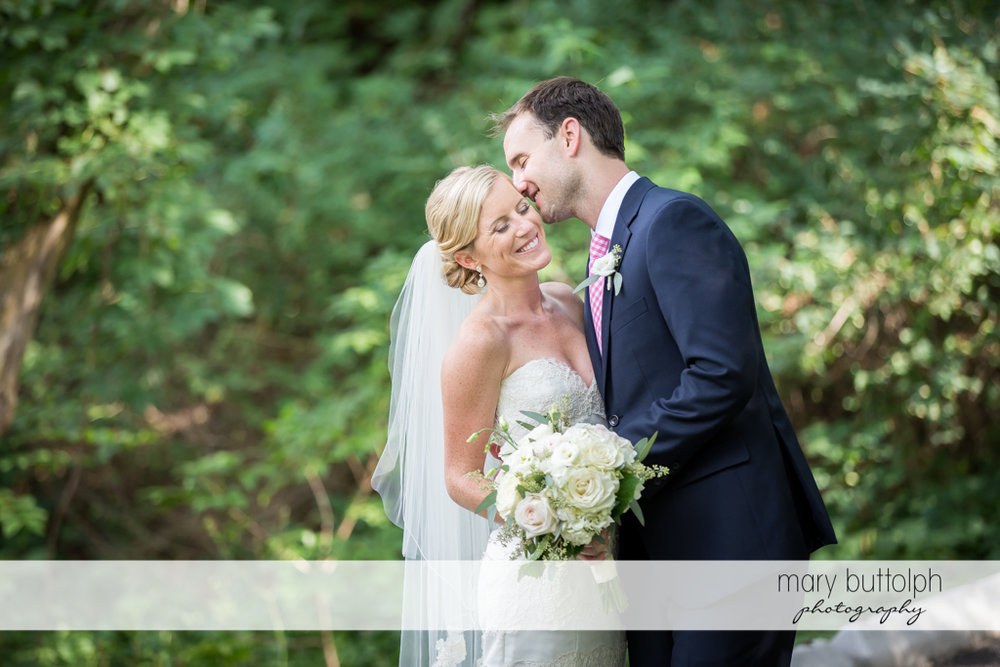 Couple in a romantic mood at the garden at Skaneateles Country Club Wedding