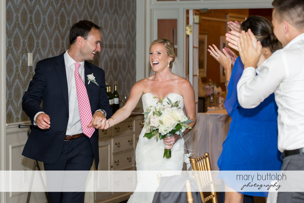 Couple are greeted by friends and family at Skaneateles Country Club Wedding