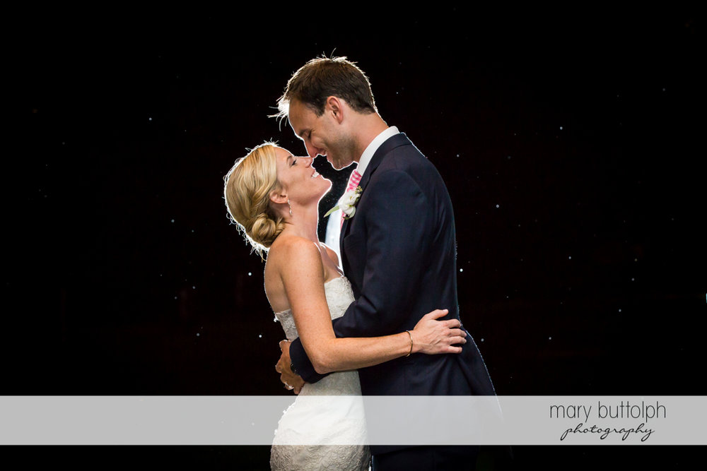Couple rub noses under the night sky at Skaneateles Country Club Wedding