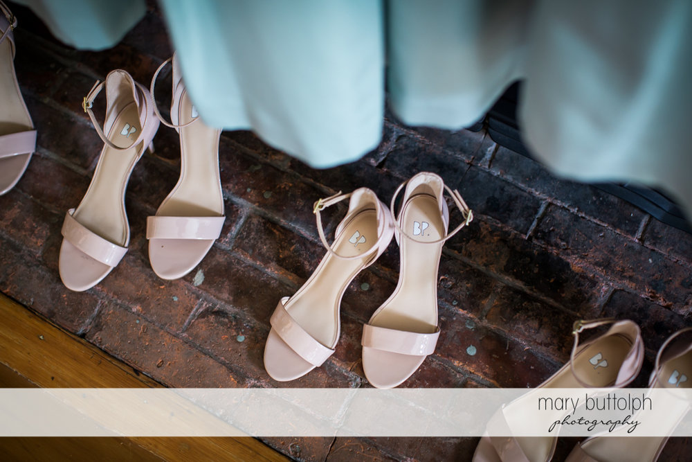 Bridesmaids' shoes on the floor at Skaneateles Country Club Wedding