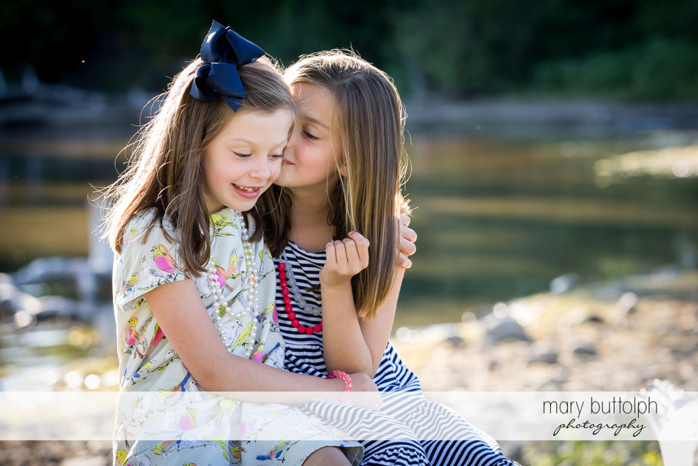 Girls share a secret near the lake at Skaneateles Country Club