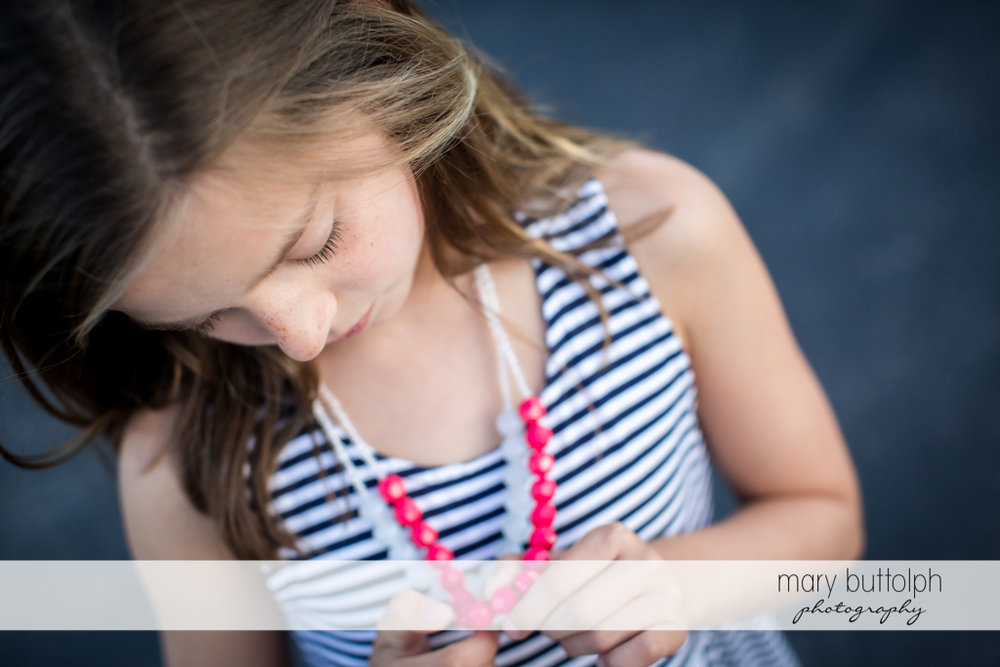 Girl examines her necklace at Skaneateles Country Club