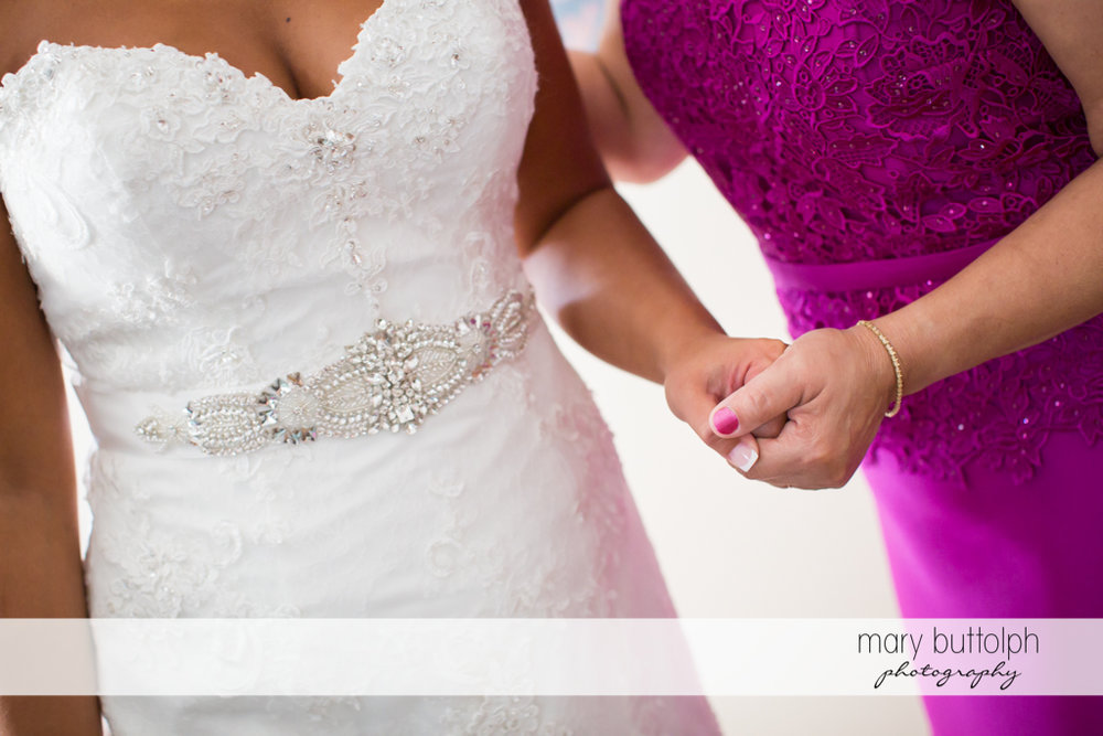 Bride holds hands with a guest at The Lodge at Welch Allyn Wedding