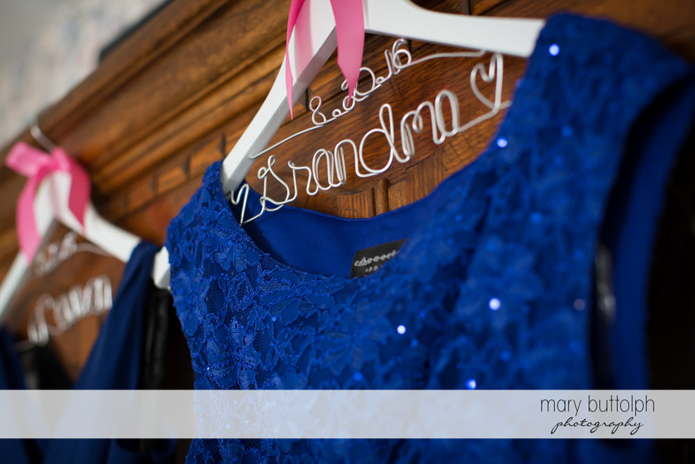 Bridesmaid's dress hangs in a room at The Lodge at Welch Allyn Wedding