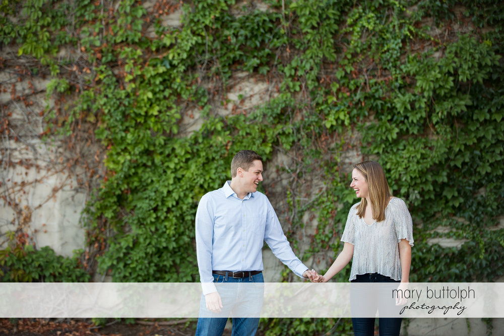 Couple hold hands at Skaneateles Engagement