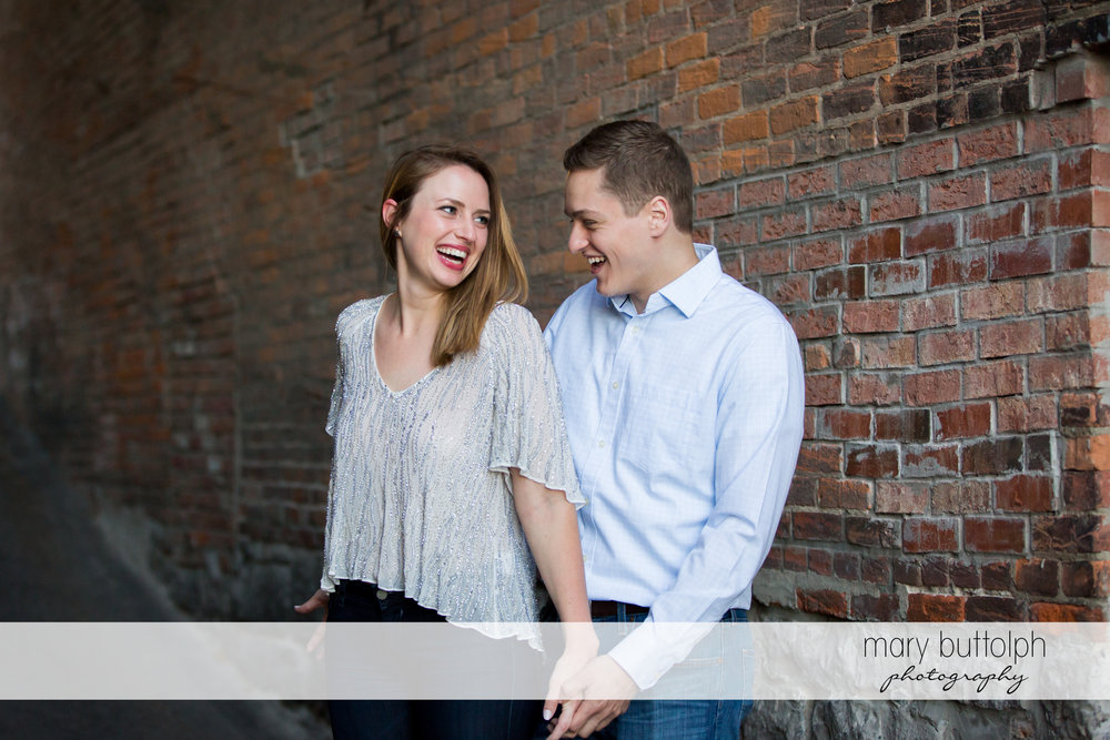 Couple laugh at Skaneateles Engagement