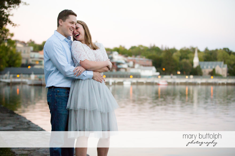 Couple enjoy view near the lake at Skaneateles Engagement