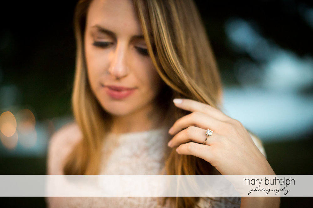 Woman touches her hair at Skaneateles Engagement