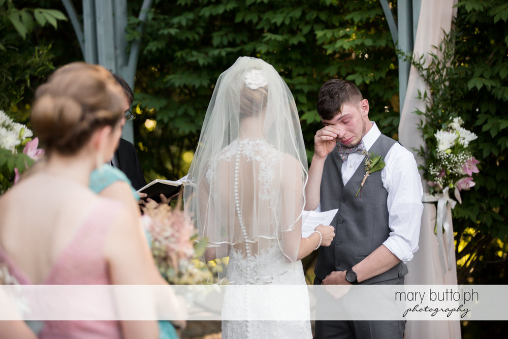 Groom cries at the garden wedding at John Joseph Inn and Elizabeth Restaurant Wedding