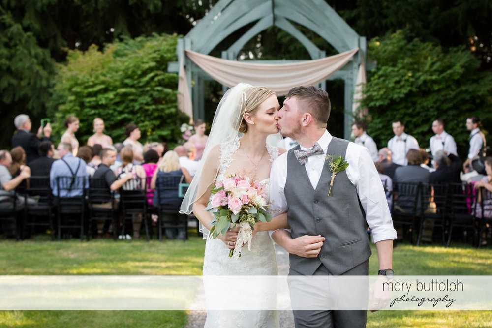 Couple kiss after the garden wedding at John Joseph Inn and Elizabeth Restaurant Wedding
