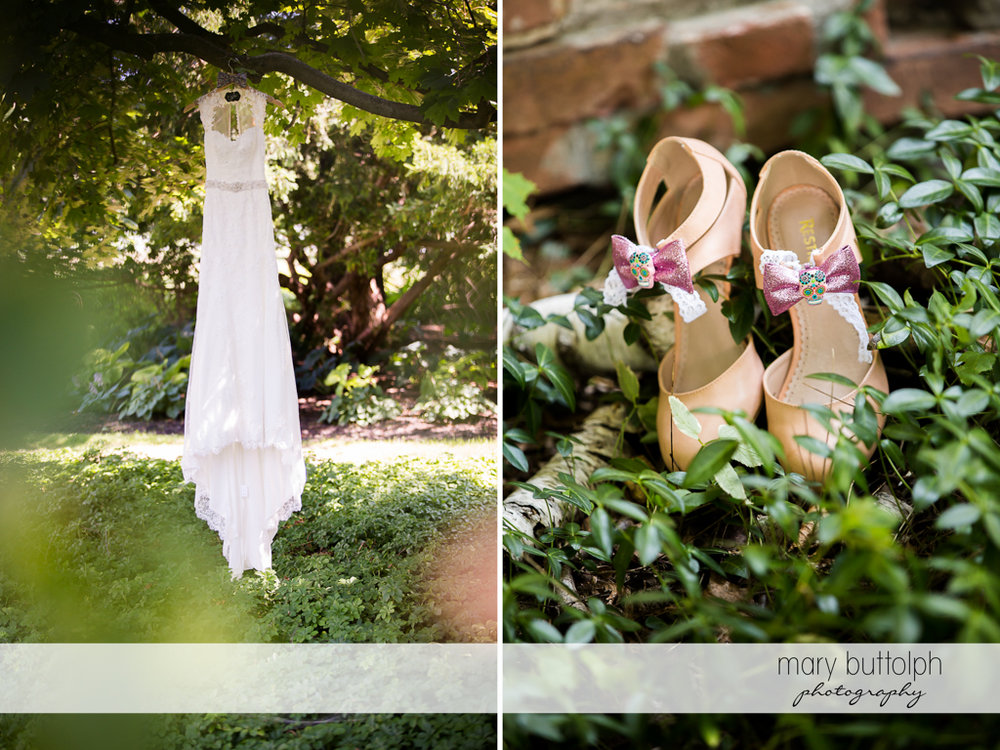 Bride's wedding dress hangs from a tree while her shoes are at the garden at John Joseph Inn and Elizabeth Restaurant Wedding