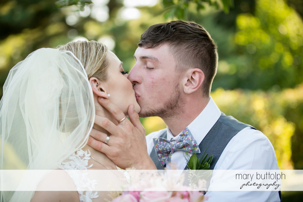 Couple kissing in close up shot at John Joseph Inn and Elizabeth Restaurant Wedding