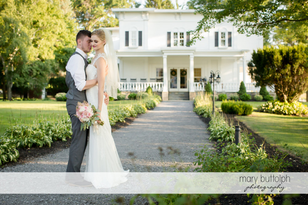 Couple pose in front of the wedding venue at John Joseph Inn and Elizabeth Restaurant Wedding