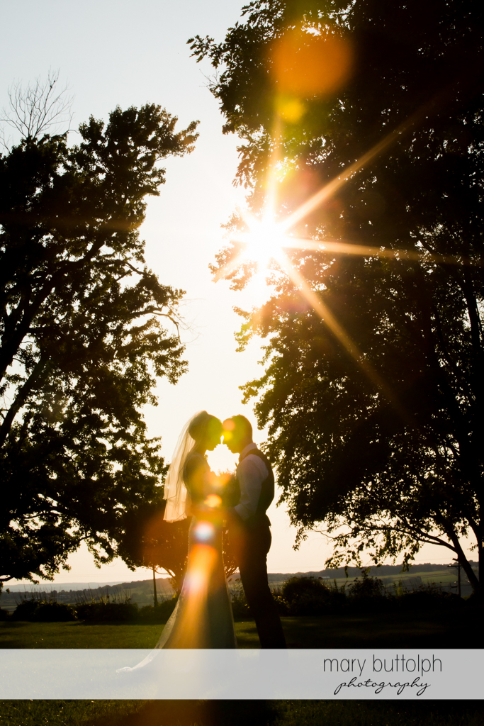 Couple catch the last rays of the sun in the garden at John Joseph Inn and Elizabeth Restaurant Wedding