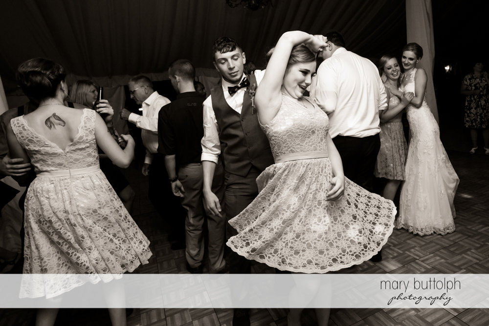 Groom dances with guest at John Joseph Inn and Elizabeth Restaurant Wedding