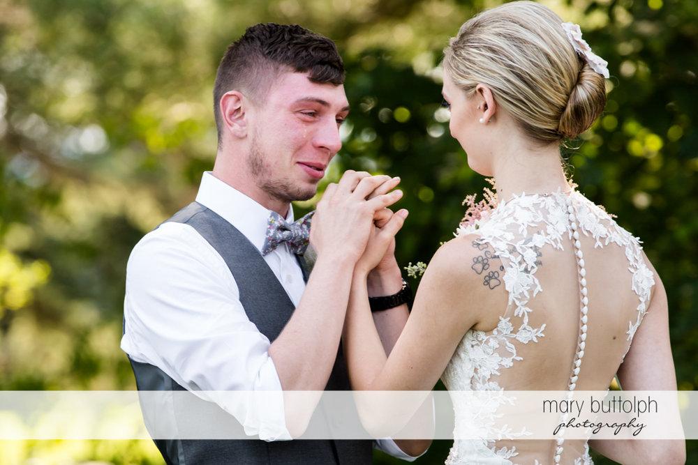 Couple hold hands in the garden at John Joseph Inn and Elizabeth Restaurant Wedding