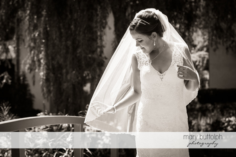 Bride in dramatic black and white shot at The Lodge at Welch Allyn Wedding