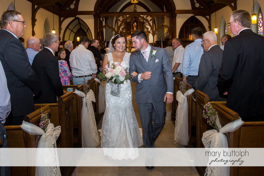 Couple leave church after the wedding at The Lodge at Welch Allyn Wedding